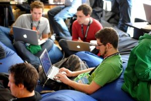 Male staff working on laptops on beanbags