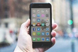 iphone with social media buttons